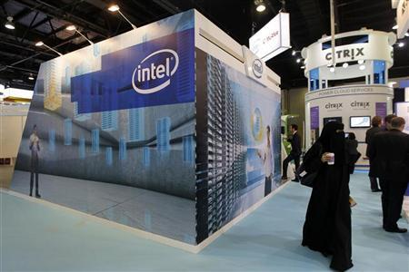 People walk past the Intel stand on the first day of the Gulf Information and Technology Exhibition (GITEX) at the Dubai World Trade Centre in Dubai October 14, 2012. REUTERS/Jumana ElHeloueh