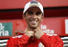 <p>Le Tribunal arbitral du sport (Tas) a annoncé qu'Alberto Contador et l'Union cycliste internationale avaient conclu un accord à l'amiable sur le montant de l'amende que paiera le coureur espagnol pour dopage. Cet accord signifie que le dossier sur la condamnation pour dopage au Clenbuterol pendant le Tour de France 2010 est clos. . /Photo prise le 7 septembre 2012/REUTERS/Miguel Vidal</p>