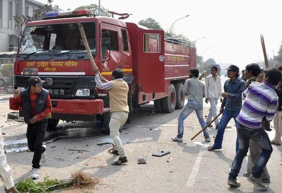 Protesters damage a fire engine during a strike in Noida, on the outskirts of New Delhi February 20, 2013. Protesting workers destroyed vehicles and damaged factories near New Delhi on Wednesday at the beginning of a two-day strike called by major trade unions over high prices. REUTERS/Stringer