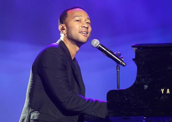 Singer John Legend performs at the annual shareholders meeting for Walmart in Fayetteville, Arkansas June 7, 2013.  REUTERS-Rick Wilking