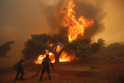 Greece battles Marathon inferno