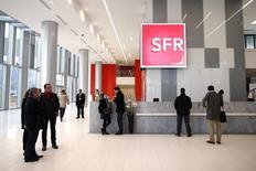 Bouygues annonce jeudi que son offre sur l'opérateur télécoms SFR valorise la filiale de Vivendi à 14,5 milliards d'euros avant synergies et qu'il prévoit de coter en Bourse le nouvel ensemble SFR-Bouygues Telecom. /Photo d'archives/REUTERS/Benoît Tessier