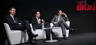 Les dirigeants d'Iliad lors de la présentation des résultats du groupe à Paris. Pour 1,8 milliard d'euros, Free est en passe de changer de division en s'offrant à moindre coût un réseau et un portefeuille de fréquences qui lui permettront d'aller rapidement talonner les leaders, si toutefois la fusion entre SFR et Bouygues Telecom aboutit. /Photo prise le 10 mars 2014/REUTERS/Jacky Naegelen
