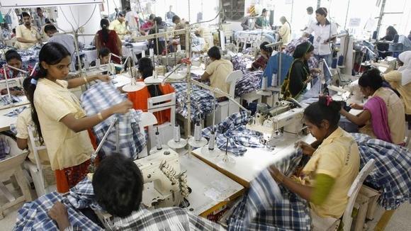 Employees work in a factory of Babylon Garments in Dhaka January 3, 2014. REUTERS/Andrew Biraj