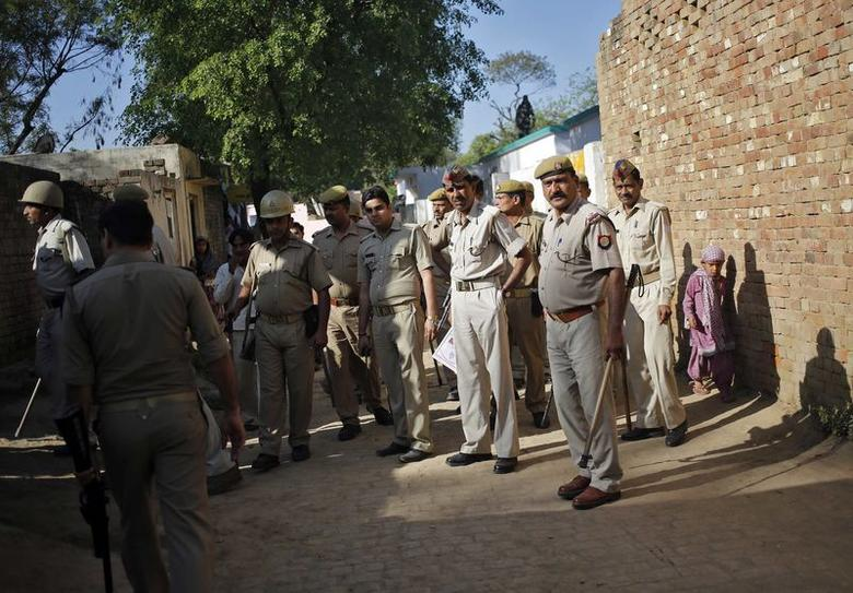 Police patrol near a polling station during the general election, in Parla village in Muzaffarnagar district in Uttar Pradesh April 10, 2014. REUTERS/Anindito Mukherjee