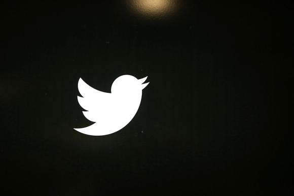 The Twitter logo is seen at the company's headquarters in San Francisco, California October 4, 2013. REUTERS/Robert Galbraith/Files