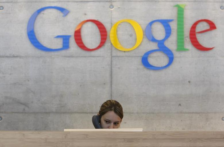 An employee answers phone calls at the switchboard of the Google office in Zurich August 18, 2009. REUTERS/Christian Hartmann/Files