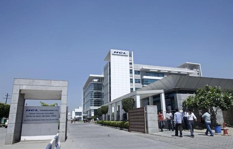 People walk in front of the HCL Technologies Ltd office at Noida, on the outskirts of New Delhi April 17, 2013. REUTERS/Mansi Thapliyal