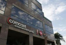 Comcast a vu son chiffre d'affaires et son bénéfice progresser au premier trimestre, le premier cablô-opérateur américain ayant enregistré une hausse du nombre de ses abonnés pour le deuxième trimestre consécutif. /Photo d'archives/REUTERS/Fred Prouser