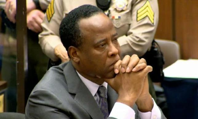 Dr. Conrad Murray listens as Judge Michael Pastor sentences him to four years in county jail for his involuntary manslaughter conviction of pop star Michael Jackson in this screen grab from pool video in Los Angeles November 29, 2011.  REUTERS/CNN/Pool/Files