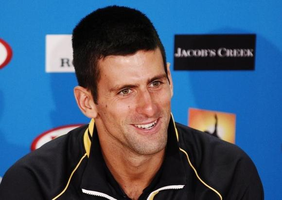 Novak Djokovic speaks at a news conference in Melbourne January 27, 2013. REUTERS/Daniel Munoz/Files