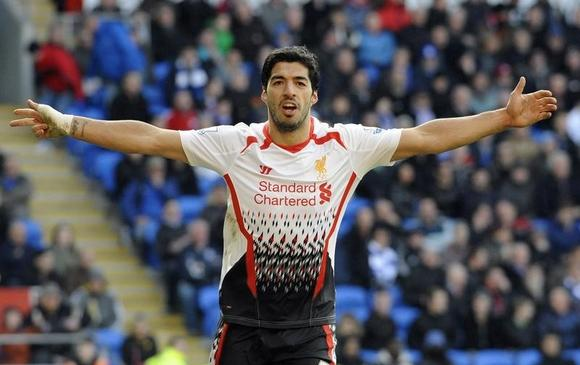Liverpool's Luis Suarez celebrates scoring his third goal against Cardiff City during their English Premier League soccer match at Cardiff City Stadium in Cardiff, Wales, March 22, 2014. REUTERS/Rebecca Naden/Files