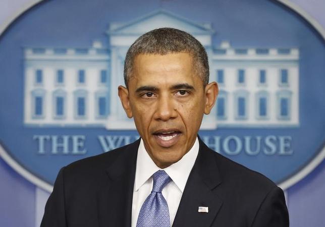 4月28日、米国はロシアに対する追加制裁を発表した。写真はオバマ大統領。ワシントンで3月撮影(2014年 ロイター/Kevin Lamarque)