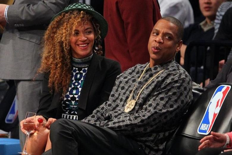 Apr 1, 2014; Brooklyn, NY, USA; Beyonce and Jay-Z watch the game between the Brooklyn Nets and the Houston Rockets during the second quarter at Barclays Center. Mandatory Credit: Ed Mulholland-USA TODAY Sports