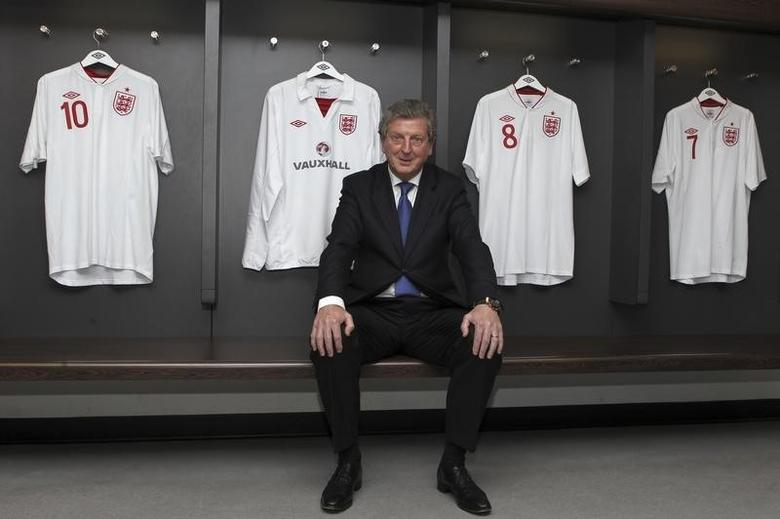 Newly appointed England soccer manager Roy Hodgson poses for a photograph in the home dressing room at Wembley Stadium in London May 1, 2012.  REUTERS/Andy Couldridge/pool