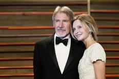 Actor Harrison Ford and his wife Calista Flockhart arrive at the 2014 Vanity Fair Oscars Party in West Hollywood, California March 2, 2014. REUTERS/Danny Moloshok
