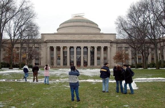 People passing through MIT's campus stop to take pictures of Massachusetts Institute of Technology's Great Dome, December 17, 2003 in Cambridge, Massachusetts. REUTERS/Jessica Rinaldi/Files