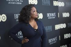 "Television personality Oprah Winfrey attends HBO's New York premiere of the documentary ""Beyonce - Life is But a Dream"" in New York February 12, 2013. REUTERS/Andrew Kelly"
