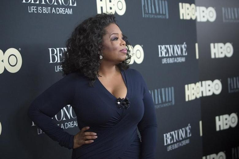 Television personality Oprah Winfrey attends HBO's New York premiere of the documentary ''Beyonce - Life is But a Dream'' in New York February 12, 2013. REUTERS/Andrew Kelly