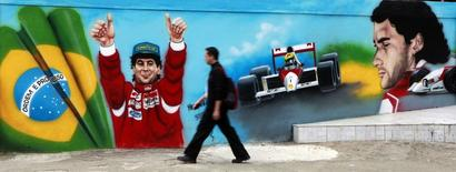 A man walks past graffiti of Brazil's Formula One driver Ayrton Senna, on the 20th anniversary of his death, in Sao Paulo May 1, 2014.  REUTERS/Paulo Whitaker