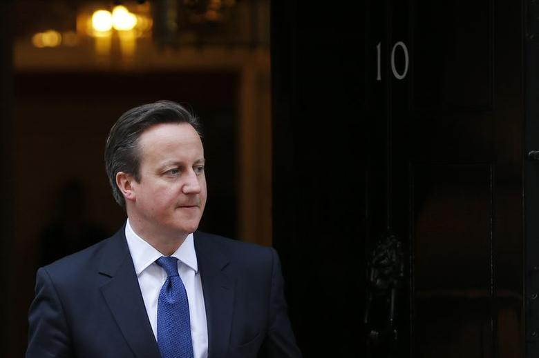 Britain's Prime Minister David Cameron awaits the arrival of Ireland's President Michael D. Higgins at Number 10 Downing Street in London April 9, 2014. REUTERS/Stefan Wermuth