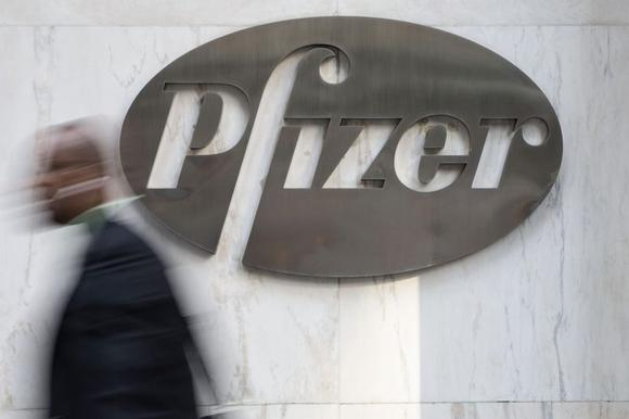 A man walks past Pfizer's world headquarters in New York April 28, 2014. REUTERS/Andrew Kelly/Files
