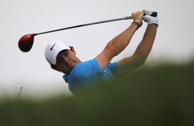 Rory McIlroy of  Northern Ireland  tees off on the third hole during Abu Dhabi Golf championship January 19, 2014.  REUTERS/Ahmed Jadallah