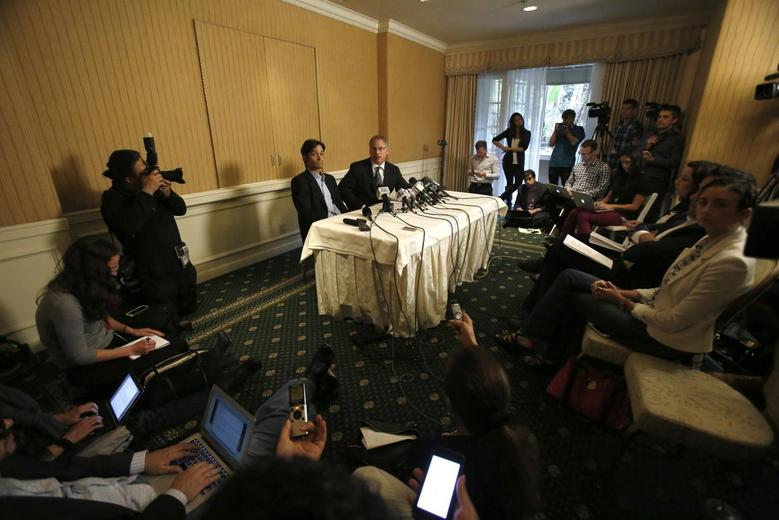 Plaintiff Michael Egan (L) speaks next to his attorney Jeff Herman at a news conference at the Four Seasons Hotel in Los Angeles, California April 17, 2014. REUTERS/Mario Anzuoni