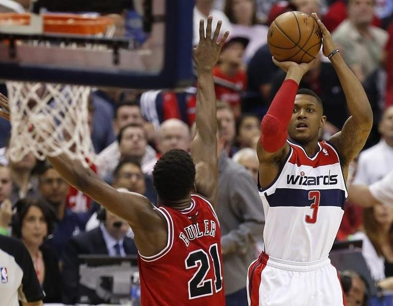 Apr 27, 2014; Washington, DC, USA; Washington Wizards guard Bradley Beal (3) shoots the ball over Chicago Bulls guard Jimmy Butler (21) in the third quarter in game four of the first round of the 2014 NBA Playoffs at Verizon Center. Geoff Burke-USA TODAY Sports