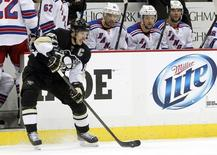 May 4, 2014; Pittsburgh, PA, USA; Pittsburgh Penguins center Sidney Crosby (87) handles the puck against the New York Rangers during the third period in game two of the second round of the 2014 Stanley Cup Playoffs at the CONSOL Energy Center. Charles LeClaire-USA TODAY Sports