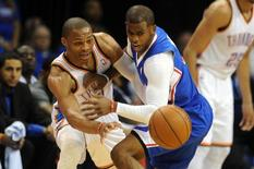 May 5, 2014; Oklahoma City, OK, USA; Oklahoma City Thunder guard Russell Westbrook (0) loses the ball while being guarded by Los Angeles Clippers guard Chris Paul (3) during the first quarter in game one of the second round of the 2014 NBA Playoffs at Chesapeake Energy Arena. Mark D. Smith-USA TODAY Sports
