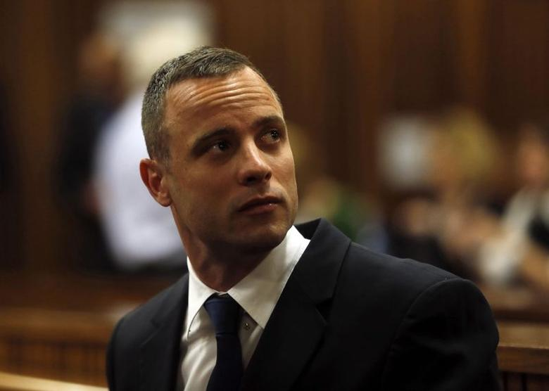 Olympic and Paralympic track star Oscar Pistorius sits in the dock in the North Gauteng High Court in Pretoria May 6, 2014. REUTERS/Mike Hutchings