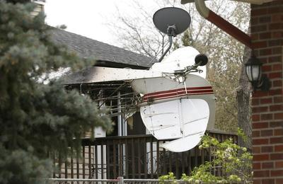 Plane crashes into house