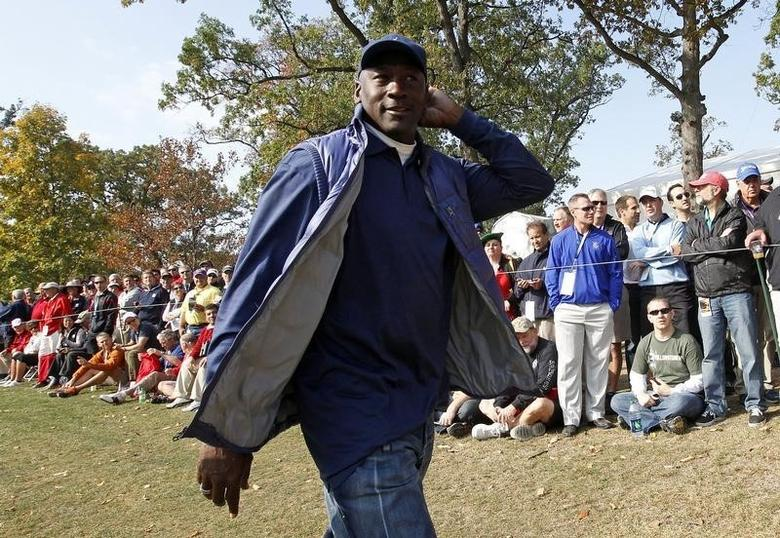 Former Chicago Bulls basketball player Michael Jordan walks along the 11th fairway during the morning foursomes round at the 39th Ryder Cup matches at the Medinah Country Club in Medinah, Illinois, September 28, 2012. REUTERS/Jeff Haynes