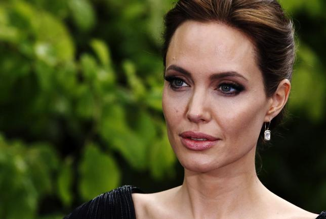 Actress Angelina Jolie arrives for a special Maleficent Costume Display at Kensington Palace in London May 8, 2014. REUTERS/Luke MacGregor