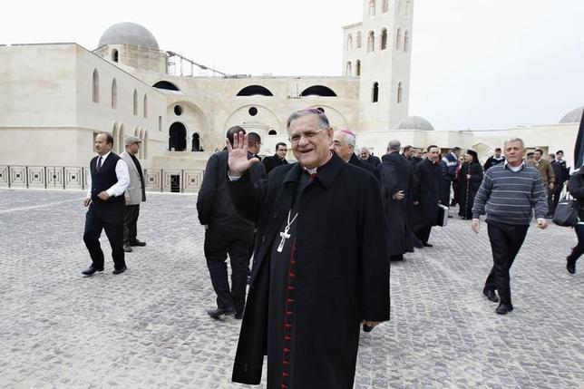Latin Patriarch of Jerusalem Fouad Twal waves to media before the religious service as part of an annual pilgrimage at a baptism site on Jordan River January 10, 2014.  REUTERS/Muhammad Hamed