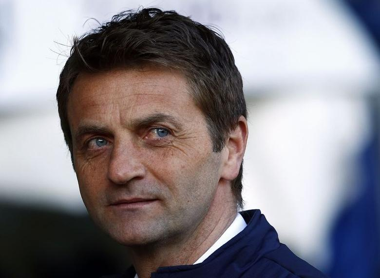 Tottenham Hotspur's manager Tim Sherwood takes his seat before their Premier League match against West Bromwich Albion at the Hawthorns in West Bromwich, central England , April 12, 2014. REUTERS/Darren Staples