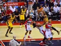 May 11, 2014; Washington, DC, USA; Indiana Pacers forward Paul George (24) shoots over Washington Wizards forward Nene Hilario (42) and is fouled during the fourth quarter of  game four of the second round of the 2014 NBA Playoffs at Verizon Center. Indiana Pacers defeated Washington Wizards 95-92. Mandatory Credit: Tommy Gilligan-USA TODAY Sports