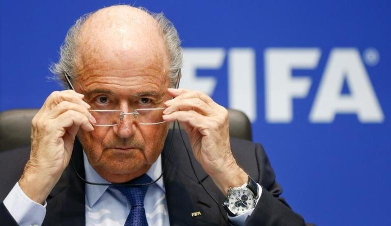 FIFA President Sepp Blatter adjusts his glasses as he addresses a news conference after a meeting of the FIFA executive committee in Zurich March 21, 2014. REUTERS/Arnd Wiegmann