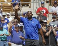 Los Angeles Dodgers co-owner Earvin Magic Johnson acknowledges the crowd before the start of a MLB Cactus League spring training baseball game against the Cincinnati Reds in Glendale, Arizona, March 22, 2013. REUTERS/Ralph D. Freso