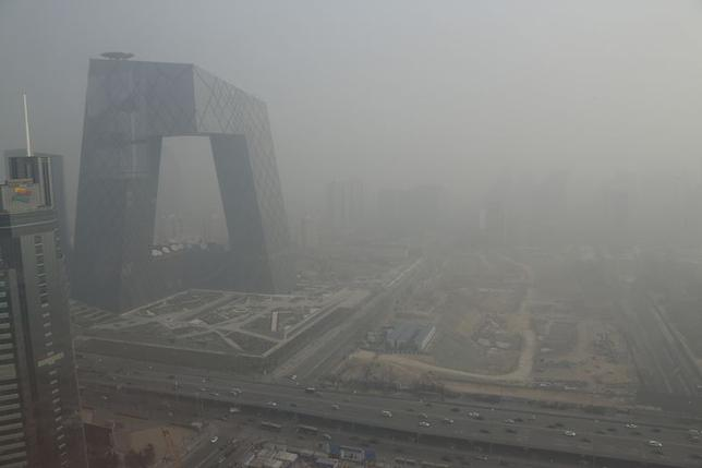 The China Central Television (CCTV) building is seen next to a construction site in heavy haze in Beijing's central business district, in this January 14, 2013 file photo. REUTERS/Jason Lee/Files