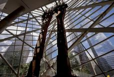 "Two steel ""tridents"" recovered from the World Trade Center site after September 11, 2001, stand in the entry pavilion area of the 911 Memorial Museum, which is under construction, at the World Trade Center site in New York, July 2, 2013.  REUTERS/Mike Segar"