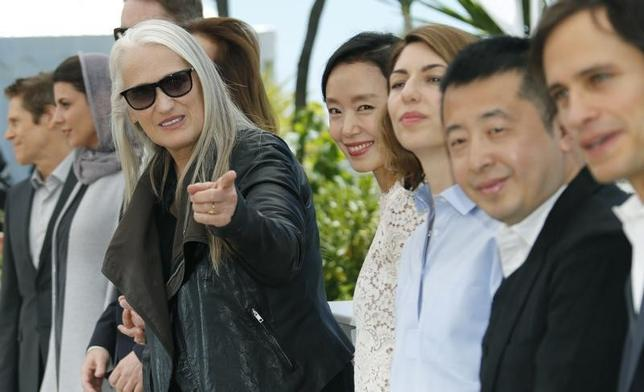 Jury President Jane Campion (C) and jury members actor Willem Dafoe (L), actress Leila Hatami (2ndL), actress Jeon Do-yeon (4thR), director Sofia Coppola (3rdR), director Jia Zhangke (2ndR), actor and director Gael Garcia Bernal (R) pose during a photocall before the opening of the 67th Cannes Film Festival in Cannes May 14, 2014.   REUTERS/Regis Duvignau