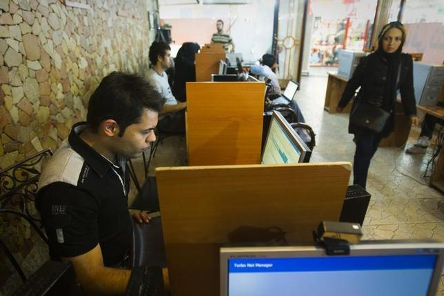 Customers use computers at an internet cafe in Tehran May 9, 2011. REUTERS/Raheb Homavandi/Files