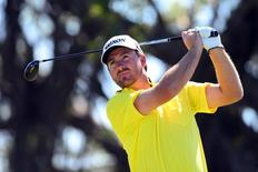 Mar 8, 2014; Miami, FL, USA; Graeme McDowell tees off from the 5th hole during the third round of the WGC - Cadillac Championship golf tournament at TPC Blue Monster at Trump National Doral. Mandatory Credit: Andrew Weber-USA TODAY Sports
