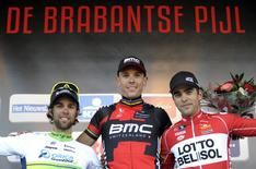Lotto Belisol team rider Tony Gallopin of France, BMC Racing team rider Philippe Gilbert of Belgium (C) and Orica Greenedge team Michael Matthews (L) of Australia pose for pictures on the podium of the Brabantse Pijl/Fleche Brabanconne cycling race in Overijse, near Brussels April 16, 2014.   REUTERS/Laurent Dubrule