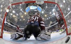 Latvia's goalie Kristers Gudlevskis reacts after a goal of the U.S. during their men's ice hockey World Championship Group B game at Minsk Arena in Minsk May 15, 2014. REUTERS/Alex Kudenko/Pool