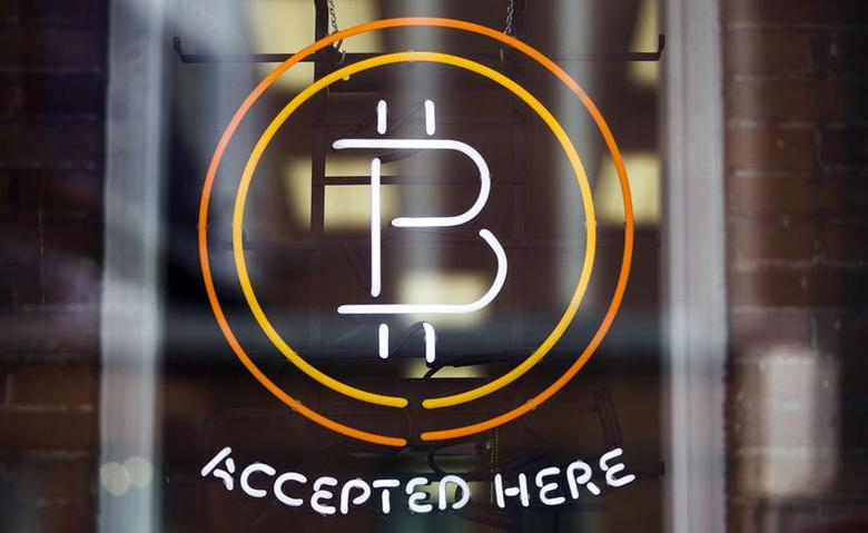 A Bitcoin sign is seen in a window in Toronto, May 8, 2014.    REUTERS/Mark Blinch (CANADA - Tags: BUSINESS LOGO) - RTR3OCTS