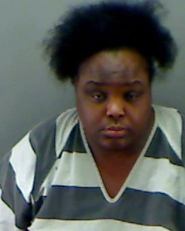 Charity Johnson, 31, is shown in this police booking photo provided by the Longview Police Department in Longview, Texas on May 15, 2014.  REUTERS/Longview Police Dept/Handout via Reuters