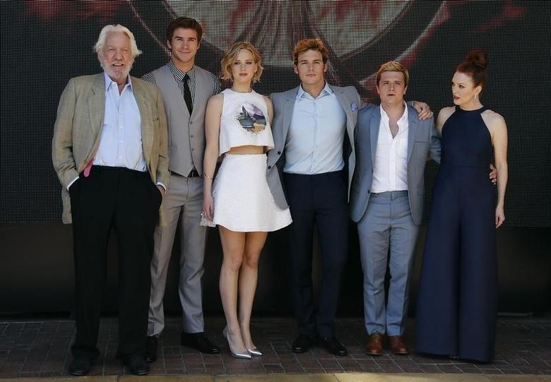 (L-R) Cast members Donald Sutherland, Liam Hemsworth, Jennifer Lawrence, Sam Claflin, Josh Hutcherson and Julianne Moore pose during a photocall for the film ''The Hunger Games : Mockingjay - Part 1'' at the 67th Cannes Film Festival in Cannes May 17, 2014.     REUTERS/Eric Gaillard